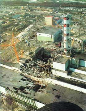 Chernobyl Disaster Aftermath:very extensive damage to the main reactor hall (image center) and turbine building (image lower left)