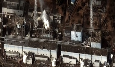 The Fukushima I Nuclear Power Plant after the 2011 Tōhoku earthquake and tsunami. Reactor 1 to 4 from right to left.